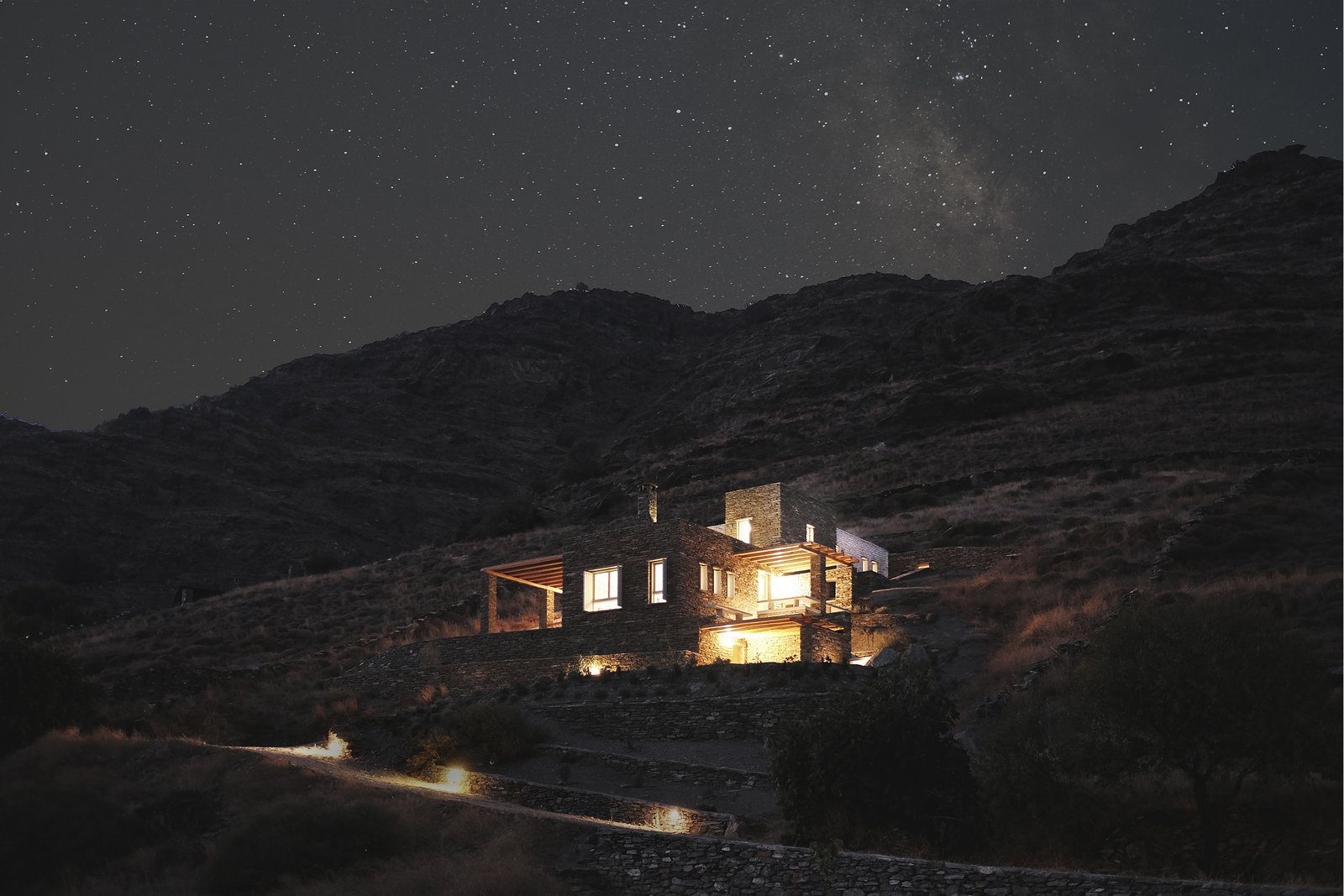 Summer night in a mediterranean island  ROCKSPLIT house by COMETA ARCHITECTS