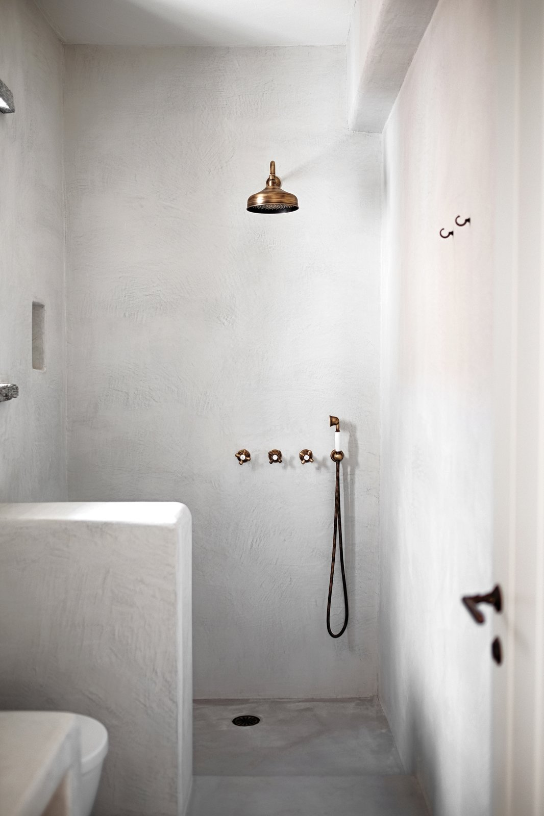 Showeroom Tagged: Bath Room, Concrete Floor, Open Shower, Corner Shower, and Concrete Wall.  ROCKSPLIT house by COMETA ARCHITECTS