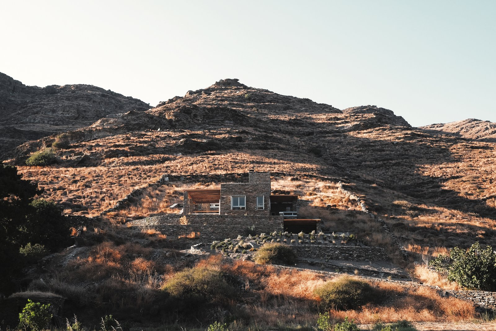 Blended in the rock, south elevation Tagged: Outdoor, Desert, and Boulders.  ROCKSPLIT house by COMETA ARCHITECTS