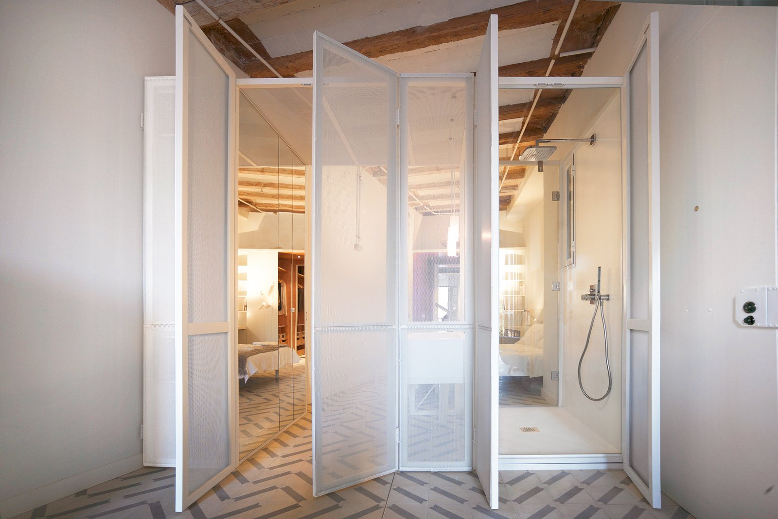 The LightBox also contains the wet area. Tagged: Bath Room, Ceiling Lighting, Pendant Lighting, One Piece Toilet, Open Shower, Freestanding Tub, and Undermount Sink.  LIGHTSLICE apartment by COMETA ARCHITECTS