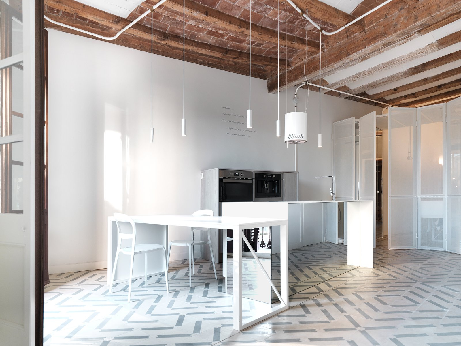 The kitchen is pivot of the house. All Lighting is custome made by the architects
