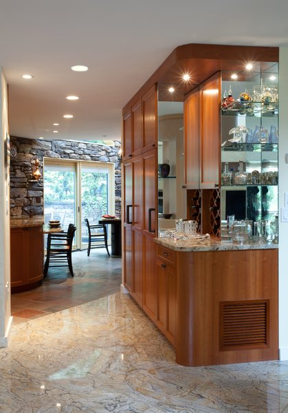 Entrance to the kitchen from the dining room area. Custom bar and storage cabinetry designed and built to match kitchen cabinetry. Photo 3 of Artisan Kitchen for a Nature Loving Family modern home