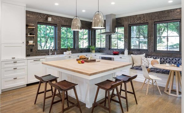 Woodblock island and a cozy banquette complete the kitchen look Photo 2 of Grant Park Dutchie modern home