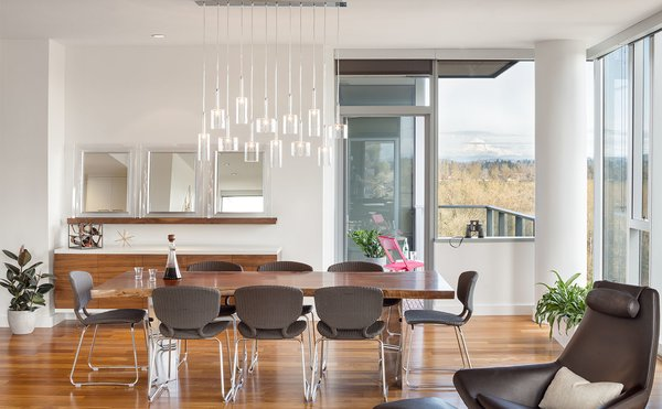 Custom, hand-blown, multi-pendant glass fixture floats above the dining table Photo 3 of Atwater modern home