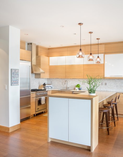 Modern home with kitchen. A purposeful kitchen layout creates a cozy, modern space to entertain or relax Photo  of Tanner Place