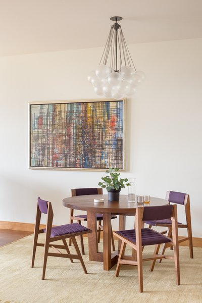 Modern home with dining room. The furniture and artwork nod at the Midcentury modern design elements that also seamlessly integrate throughout the condo.  Photo 3 of Tanner Place