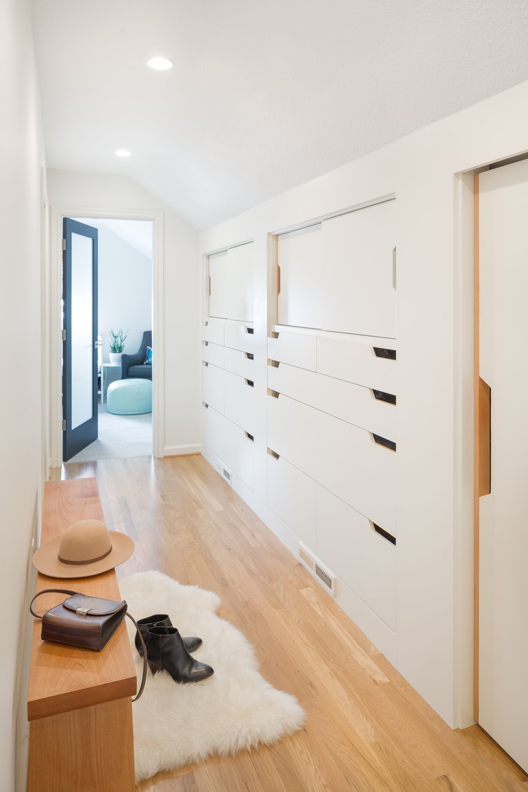 The bright white hallway adds a lot of storage and still feels spacious