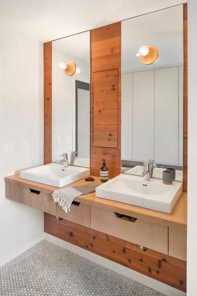 Modern home with light hardwood floor and bath room. Mixed materials create a sleek, earthen inspired vanity  Photo 2 of Hurst Avenue