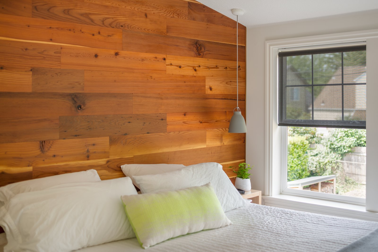 Cozy and minimalist, the wall becomes the headboard and focal point