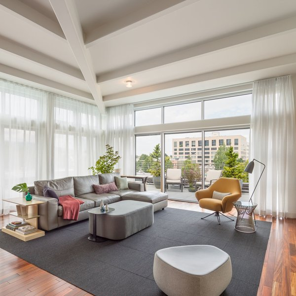 Modern home with living room. Spacious ceiling heights with specific furniture elude to restful luxury  Photo  of Block 90 Penthouse