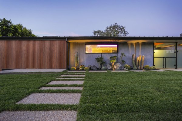 Front Walkway - A Hidden Service Entrance Door in the Cedar Siding uses a keyfob to electronically open the door. Photo 9 of The Pinstripe House - Mid-Century Modern Minimalism. Available for $7,750,000 modern home