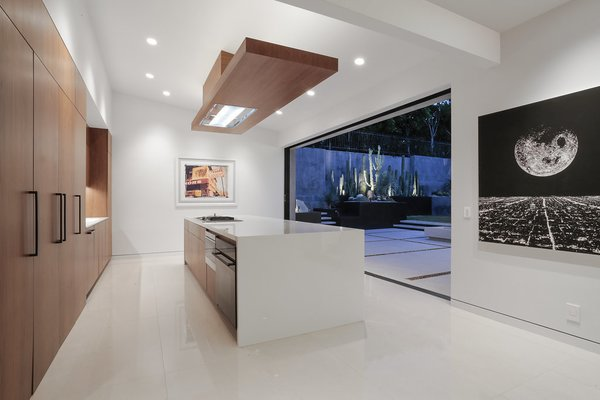 Entertaining Kitchen Photo 16 of The Pinstripe House - Mid-Century Modern Minimalism. Available for $7,750,000 modern home