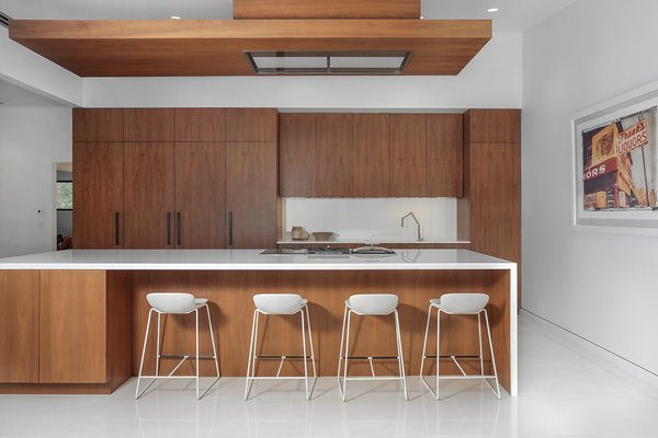 Entertaining Kitchen Photo 17 of The Pinstripe House - Mid-Century Modern Minimalism. Available for $7,750,000 modern home