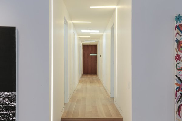 Hallway of the Bedroom Wing Photo 20 of The Pinstripe House - Mid-Century Modern Minimalism. Available for $7,750,000 modern home