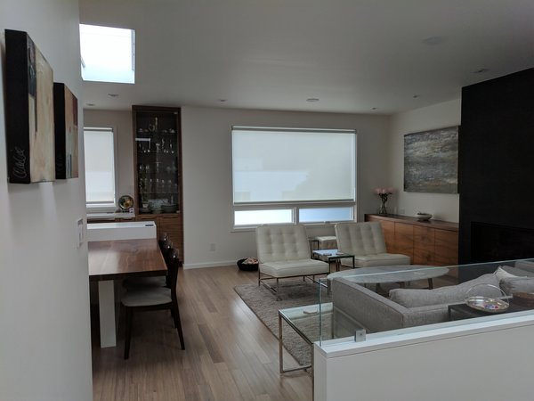 Modern home with living room, gas burning fireplace, and recessed lighting. Photo  of Glen Park