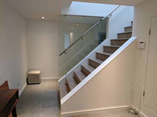 Modern home with staircase, wood tread, glass railing, and metal railing. Photo 8 of Glen Park