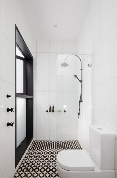 The ensuite bathroom and shower zone connects to a verdant private courtyard. Photo 10 of Enmore House modern home