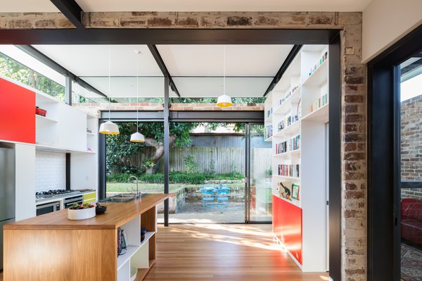 Sliding glazed panels stack back allowing the living spaces to spill out to the terraced courtyard and yard. Photo 5 of Enmore House modern home