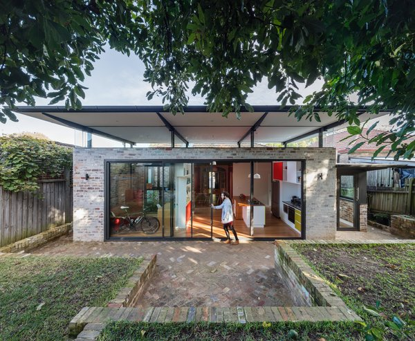 The soaring canopy roof provides visual impact offering protection and shelter to the renewed indoor and outdoor living spaces to the rear of the home. Photo 2 of Enmore House modern home