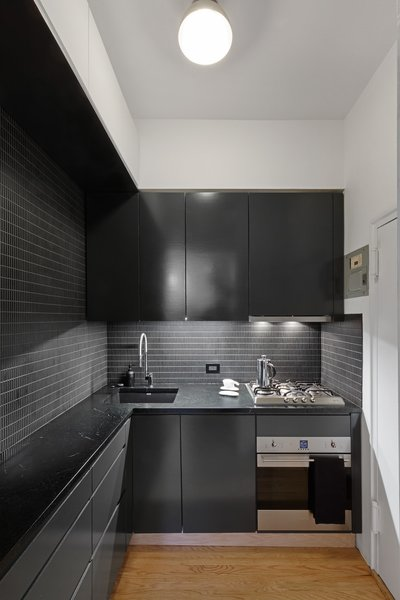 Modern home with kitchen. Photo 2 of Overhaul of an Upper West Side Brownstone Apartment