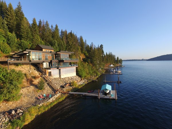 A palette of concrete, cold rolled steel, exposed structure, glass & reclaimed redwood make for an exciting recreational home on one of N. Idaho's gems, Lake Coeur d'Alene. Photo  of Cliffside House modern home