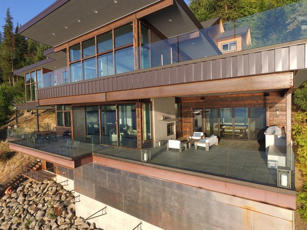 Outdoor living space is combined in both covered & uncovered patios equal to one complete floor of conditioned space, truly bringing the outside in. Photo 2 of Cliffside House modern home