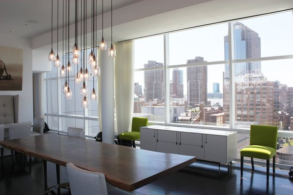 Modern home with dining room, table, ceiling lighting, storage, dark hardwood floor, and chair. Photo 3 of Downtown Penthouse