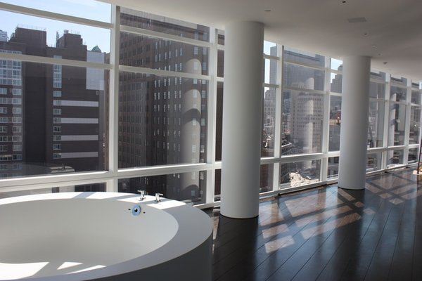 Modern home with bath room and dark hardwood floor. Photo 6 of Downtown Penthouse