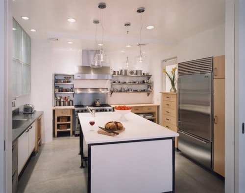 Modern home with kitchen, ceiling lighting, wood cabinet, and refrigerator. Photo 2 of Artist's Residence
