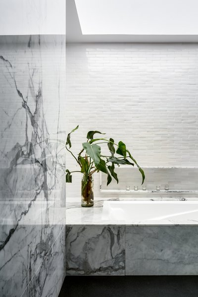 Modern home with bath room, marble counter, stone tile wall, and marble wall. Photo 9 of Monte Parnaso House