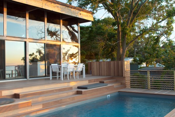Sunset Pool View Photo  of Bay Walk Residence modern home