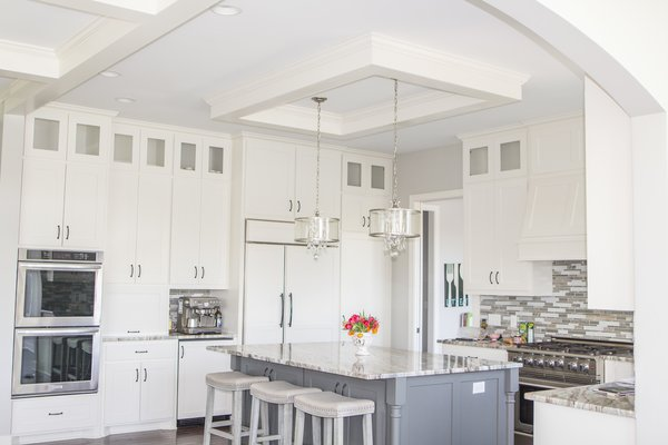 Kitchen ceiling enhancement. Clean white vibe to the island area.  Photo  of Minnesota Home modern home