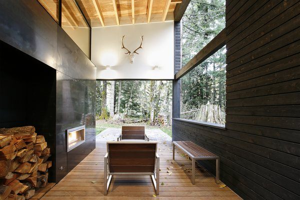 Modern home with outdoor and wood patio, porch, deck. Photo 5 of Courtyard House on a River
