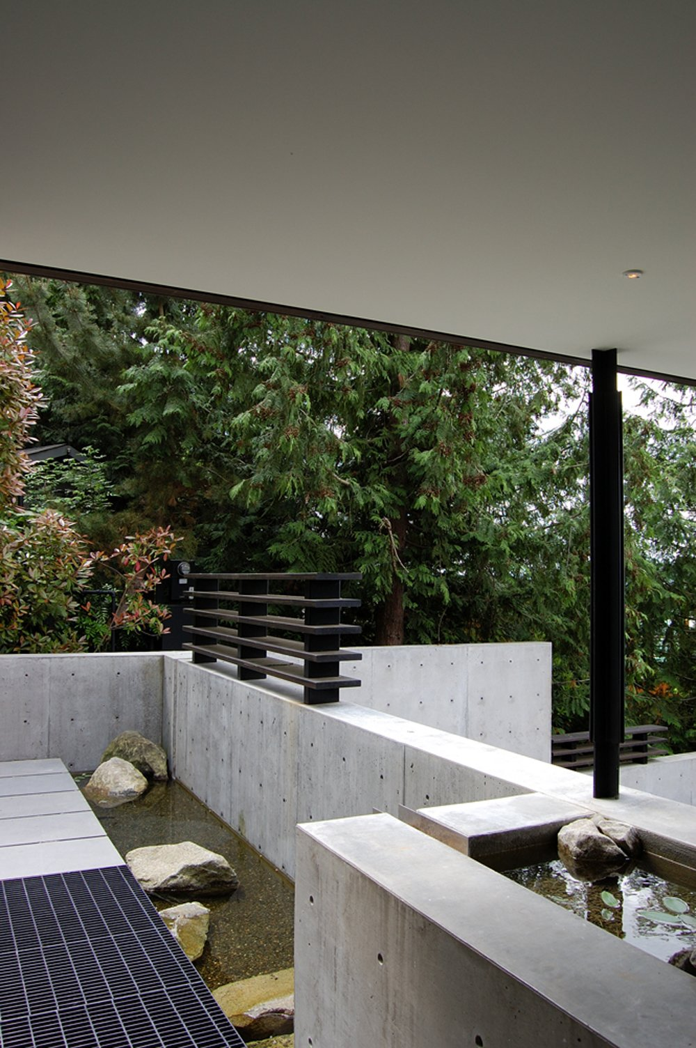 Tagged: Outdoor, Small Pool, Boulders, and Concrete Pool. Courtyard House on a Steep Site by Robert Hutchison Architecture