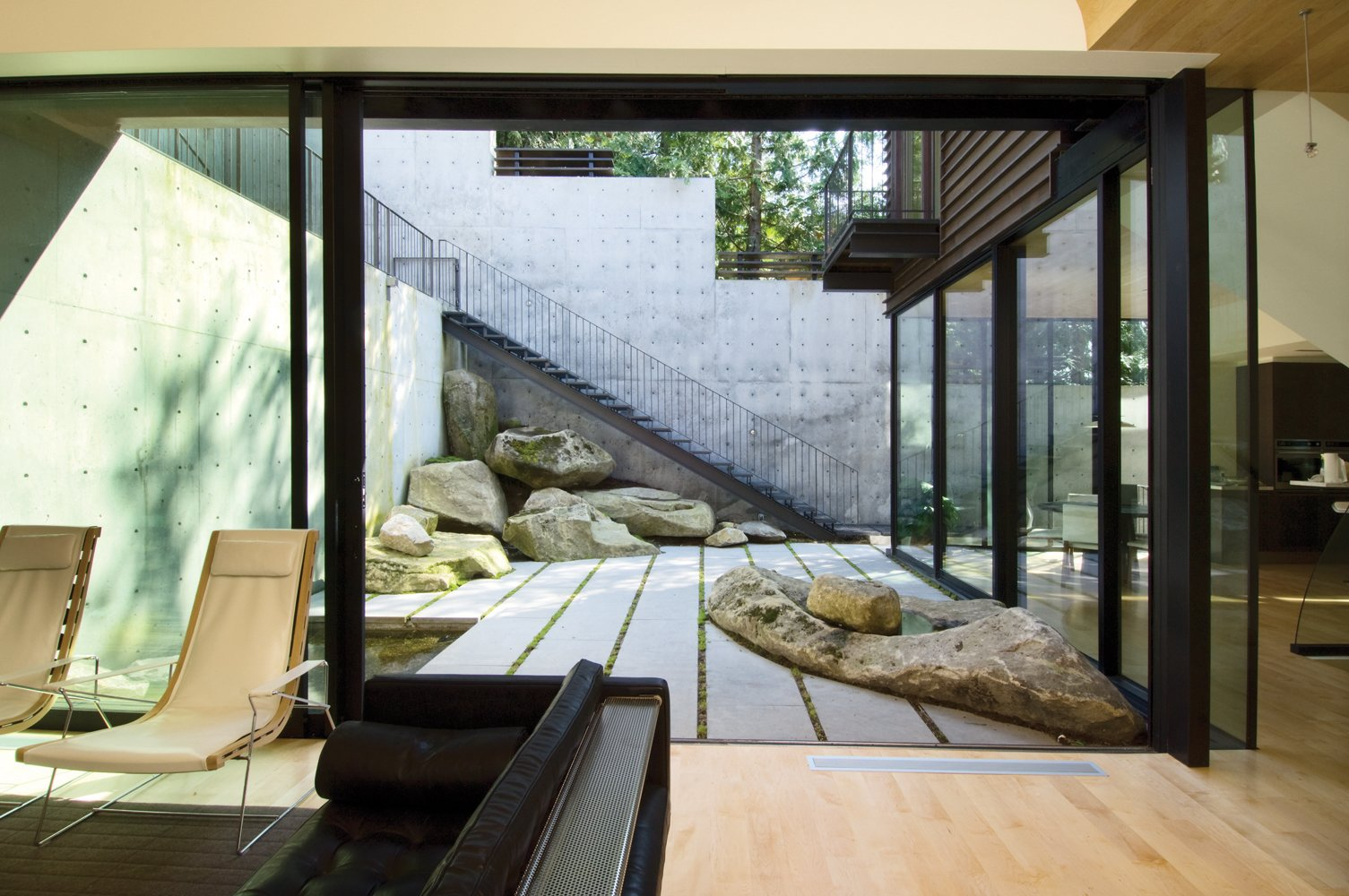 Tagged: Outdoor, Small Pools, Tubs, Shower, and Boulders.  Courtyard House on a Steep Site by Robert Hutchison Architecture