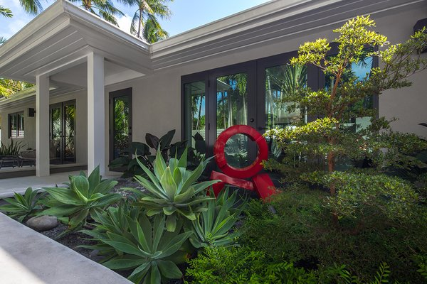 Modern home with outdoor, garden, front yard, hardscapes, trees, shrubs, gardens, concrete patio, porch, deck, raised planters, and small patio, porch, deck. An outdoor extension of the living room.  The planting more a visual point of the living room and the sculpture is by Rob Lorenson. Photo 3 of Modernist Retreat
