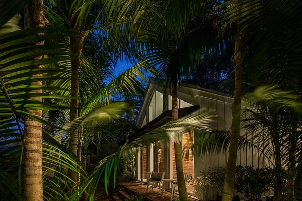 Modern home with outdoor, back yard, shrubs, trees, garden, gardens, hardscapes, walkways, pavers patio, porch, deck, small patio, porch, deck, and landscape lighting. Landscape lighting helps to create drama  Photo 18 of Key West Classic
