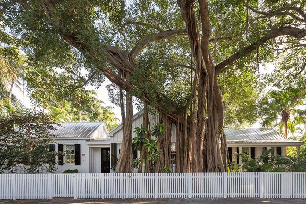 Modern home with outdoor, front yard, garden, trees, hardscapes, gardens, walkways, wood patio, porch, deck, and wood fence. Photo  of Key West Classic
