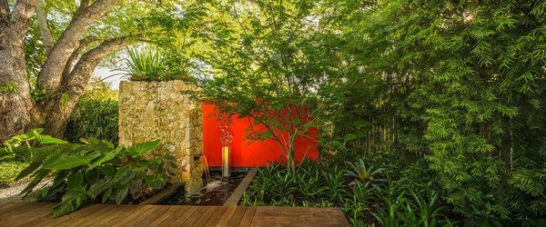 The bold red wall acts as an anchor behind the water feature leading your eye down the path creating a longer site line.  Photo 3 of Von Phister modern home
