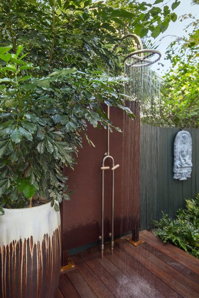Modern home with outdoor, garden, side yard, gardens, walkways, hardscapes, wood patio, porch, deck, shrubs, decking patio, porch, deck, and landscape lighting. An outdoor shower was placed near the pool but tucked away to allow some privacy for those using it. Photo 8 of Von Phister