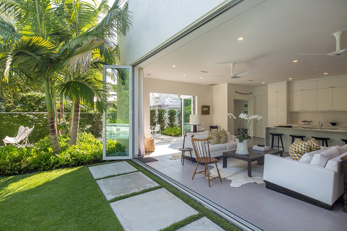 Indoor/outdoor living in 'key' here in the Florida Keys. Tagged: Outdoor, Back Yard, Trees, Side Yard, Shrubs, Grass, Garden, Hardscapes, Small Patio, Porch, Deck, Landscape Lighting, Walkways, and Concrete Patio, Porch, Deck.  Tropical Minimal by Craig Reynolds Landscape Architecture
