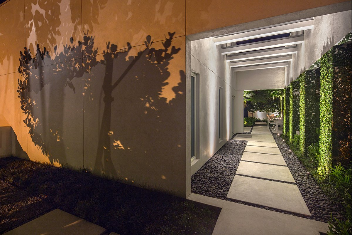 Lighting is used to create drama, as well as, safety to this modernist retreat. Tagged: Outdoor, Front Yard, Walkways, Side Yard, Hardscapes, Trees, Concrete Patio, Porch, Deck, Small Patio, Porch, Deck, Pavers Patio, Porch, Deck, and Landscape Lighting. Tropical Minimal by Craig Reynolds Landscape Architecture