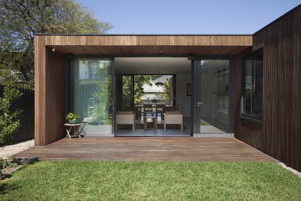Modern home with outdoor, small patio, porch, deck, wood patio, porch, deck, grass, and back yard. Photo 3 of Humble House