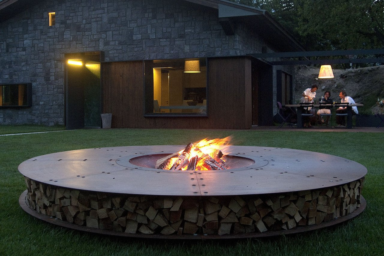 Tagged: Outdoor, Back Yard, and Grass.  Fire by Casey Tiedman from Gather Around These 7 Modern Fire Pit Designs