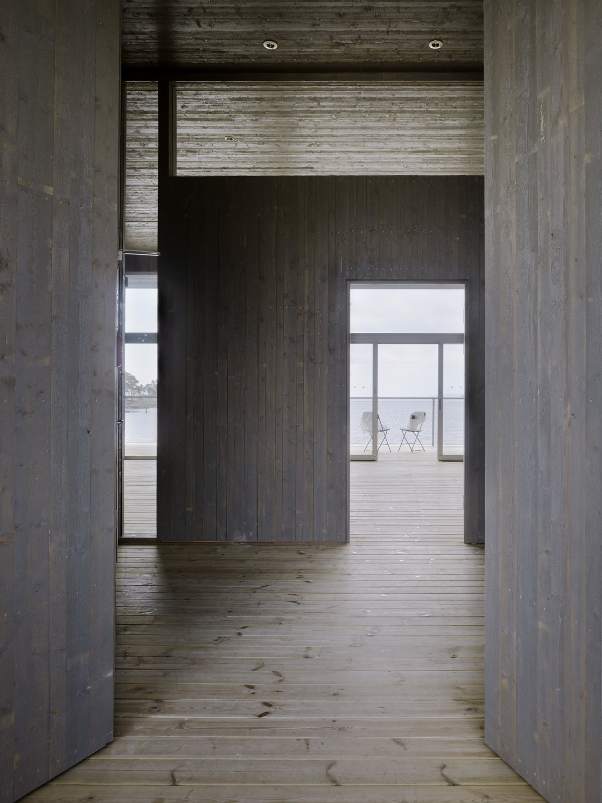 Tagged: Hallway and Light Hardwood Floor.  Photo 5 of 6 in A Swedish Coastal Town Commissions an Otherworldly Bathhouse