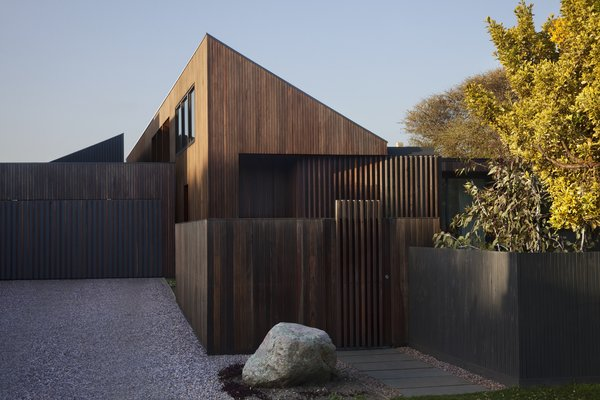 Modern home with attached garage, wood, exterior, swing door type, and garage. Photo 6 of Humble House