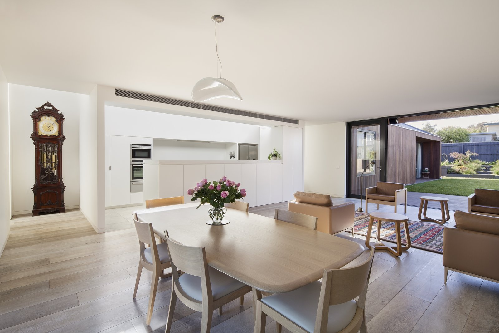 Tagged: Dining Room, Table, Pendant Lighting, Chair, and Light Hardwood Floor.  Photo 2 of 6 in A Timber-Clad Home in Australia Is a Striking Place to Grow Old In