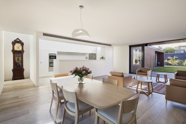 Modern home with dining room, table, pendant lighting, chair, and light hardwood floor. Photo 2 of Humble House