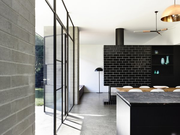Modern home with dining room and concrete floor. Photo 9 of Elwood House