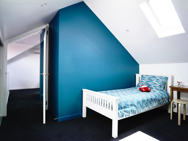 Modern home with bedroom, bed, and recessed lighting. Photo 8 of Elwood House